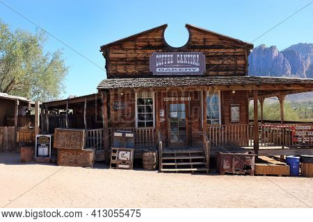 APACHE JUNCTION, ARIZONA - DECEMBER 8, 2016: Coffee Cantina and Bakery at the Goldfield Ghost Town, in Apache Junction, Arizona, off of Route 88.  With the Superstition Mountains in the background.