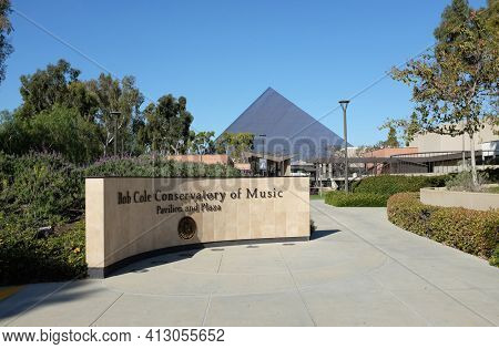 LONG BEACH, CALIFORNIA - 16 MAR 2021: Sign at the Bob Cole Conservatory of Music on the Campus of Cal State University Long Beach with thePyramid rising in the background.