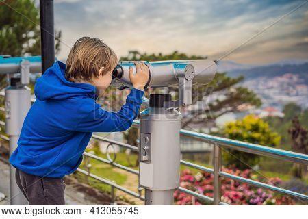 Binoscope. Stationary City Binoculars. A Boy Looks At The City Through A Binoscope