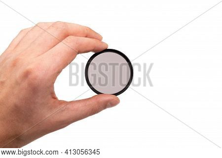Polarizing Filter For The Camera In Hand. Isolated On A White Background