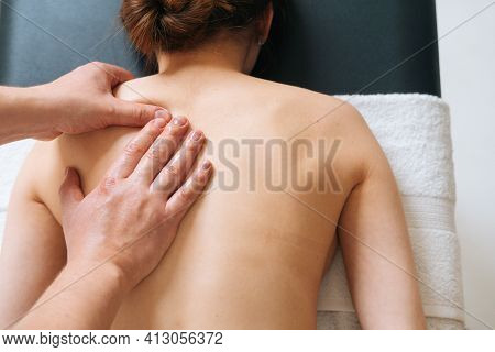 Top View Of Male Masseur With Strong Hands Professionally Massaging Scapulas And Shoulders. Beautifu