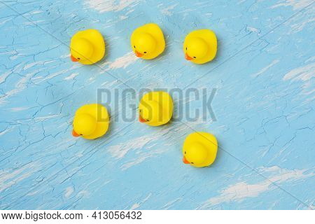 Yellow Rubber Ducks On A Blue Background. Top View