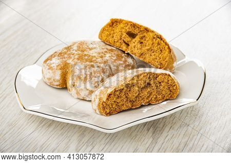 Whole Gingerbread, Broken Gingerbread In White Saucer On Light Wooden Table