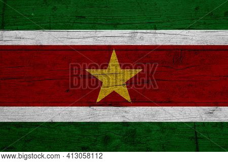Flag Of Suriname. Wooden Texture Of The Flag Of Suriname.