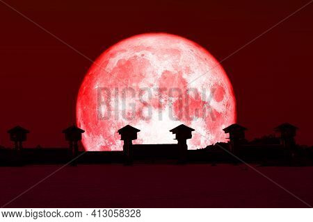 Super Red Moon And Silhouette Dam In The Dark Red Sky