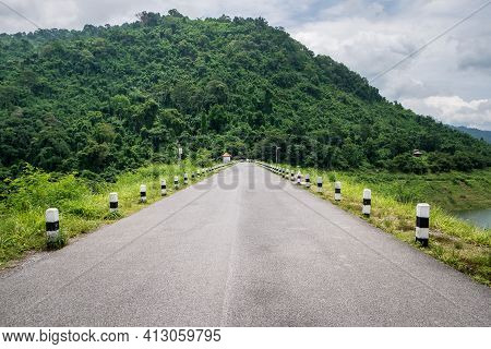 Country Road In The Forest, Nakhon Nayok Province, Thailand. Khun Dan Prakan Chon Dam.