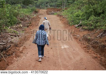 Asian Muslim Couple Man And Woman Supervisor Checking New Open Road Construction Plan Project
