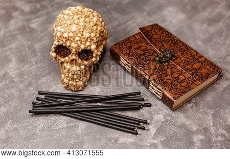 Objects Skull, Black Candles, Old Book For Magical Rituals On Dark Background. Black Candles With Sk