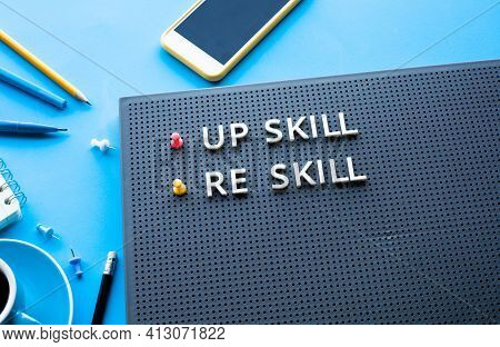 Up Skill And Re Skill Text On Desk Table. Performance Or Development Concepts Ideas