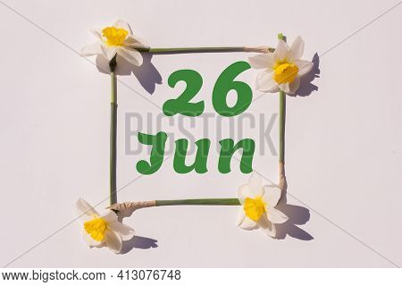June 26th. Day 26 Of The Month, Calendar Date. Frame From Flowers Of A Narcissus On A Light Backgrou