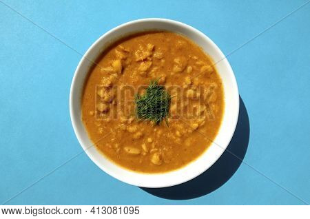 Famous Traditional Arabic Cuisine - Plain Peeled Fava Beans In A White Bowl On Blue Background. Top