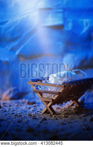 Wooden Manger And Star Of Bethlehem In Cave, Nativity Scene Background. Christian Christmas Concept.