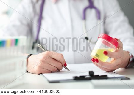 Medical Officer Holds Container With Urine Sample