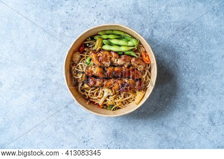 Take Away Japanese Yakitori Chicken With Noodle And Edamame Beans In Take Out Plastic Bowl. Ready To