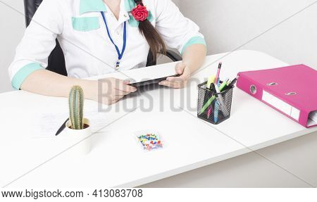 Doctor Psychologist In A Psychologist S Office At A White Table. The Concept Of Providing Psychologi