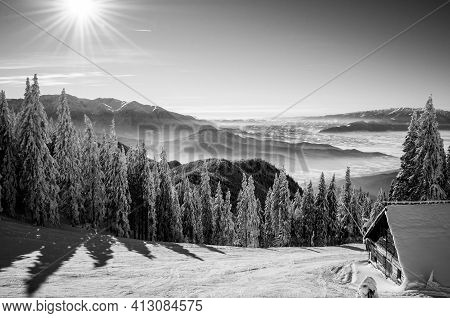 Black And White Winter Scenery  In Postavaru Massif With A Small Wood Cabin