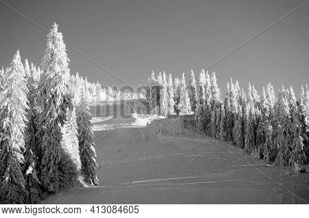 Black And White Empty Ski Slope In Postavaru Massif