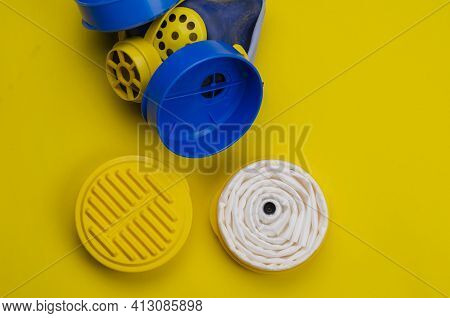 Industrial Respirator With Replaceable Filters On A Yellow Background. Plastic Personal Respiratory