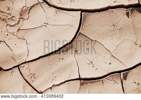 Water Crisis. Cracked Earth. Global Warming Problem. Dry Land Ground. Desert Concept. Cracked Soil C