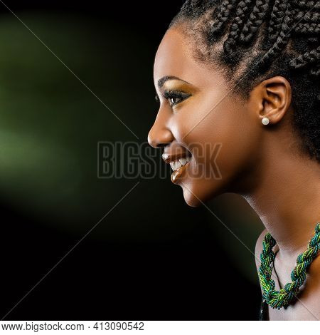 Close Up Studio Portrait Of Young Attractive Afro American Woman With Charming Smile. Profile Of Gir