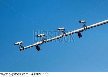 Four Cctv Cameras Mounted On The Mast Of The Road Post. All 4 Cameras Are Looking In The Same Direct