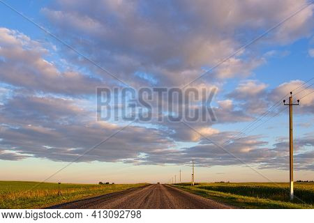 Beautiful White Small Clouds On Blue Sky At Sunrise