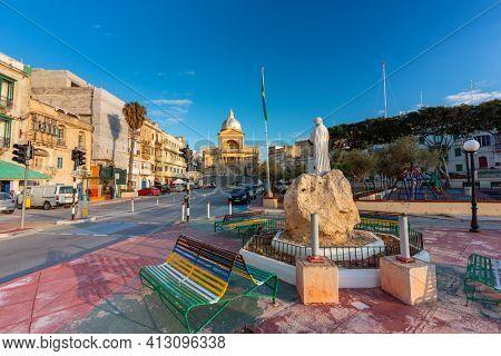 Birgu, Malta - January 10, 2019: Beautiful architecture of the Birgu marina at sunset, Malta