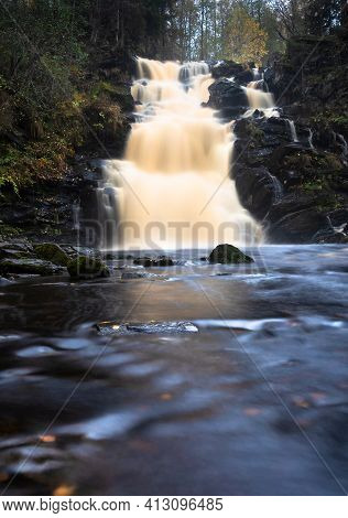 Amazing Mountain Waterfall Landscape. Autumn Forest And Waterfall Background.