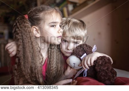 Little Boy Twirling Her Sisters Beautiful Hair In Fingers To Calm Down, Negative Emotions