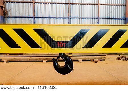 Crane Hook On A Yellow Metal Girder. Carrying Capacity Ten Tons. Lifting A Load Weighing Ten Tons. L