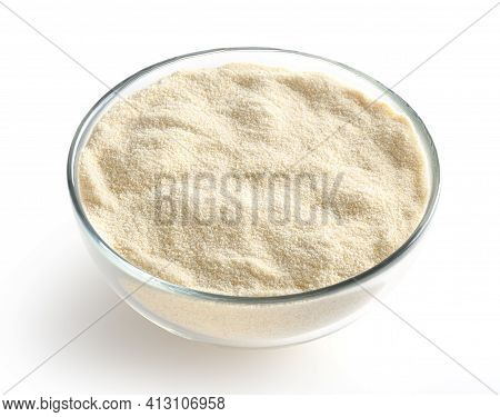 Semolina Flour In Glass Bowl Isolated On White Background