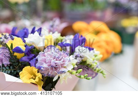 A Chic Multi-colored Bouquet Of Flowering Iris, Cloves And Hyacinth. Festive Design Of The Windows O