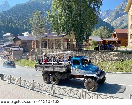 Dombay, Russia - August 15, 2020: Off-road Passenger Expedition Truck With Tourists Heading For An E
