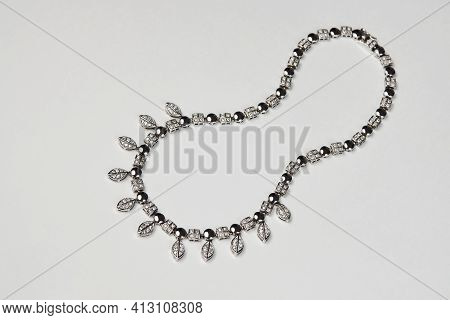 Elegant Necklace With Diamonds On White Background With Copy Space