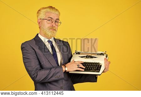 Salesman Vintage Objects. Mature Man Dyed Beard Hair Yellow Background. Used Goods Store. Connoisseu