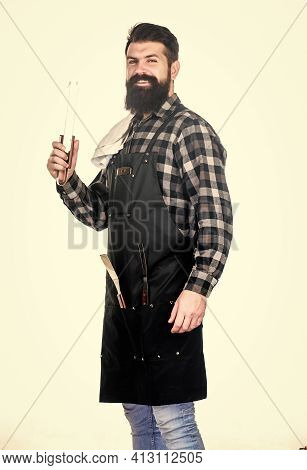 Barbecue And Grill. Barbecue Cook Using Kitchen Tongs. Bearded Man Holding Barbecue Tongs In Hands.
