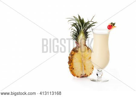 Pina Colada Cocktail In Glass Isolated On White Background. Copy Space