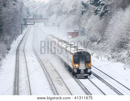 commuter train travelling in snow