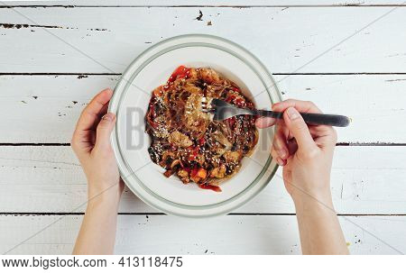 Funchosa In A Plate Of Asian Food, European Woman Eating Asian Food With A Fork, Asian Difficulties