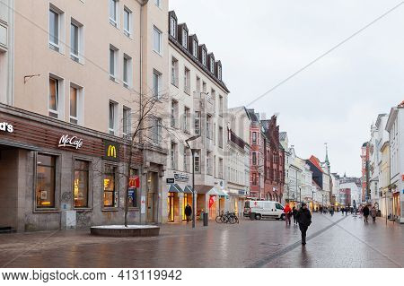 Flensburg, Germany - February 8, 2017: Ordinary People Are On The Grosse Strasse, It Is A Central Sh