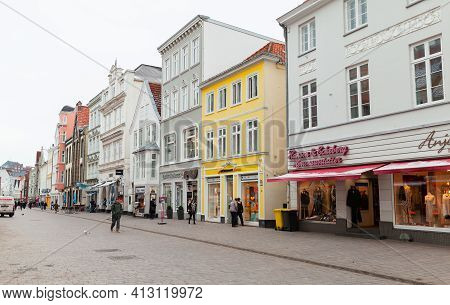 Flensburg, Germany - February 9, 2017: Ordinary People Are On The Grosse Strasse On A Daytime, It Is