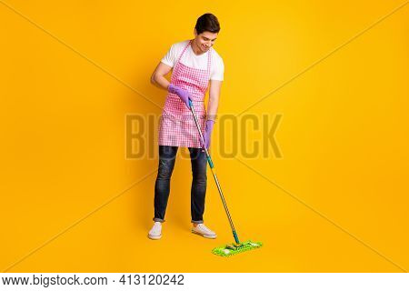 Full Size Photo Of Young Happy Positive Good Mood Smiling Man Cleaning Washing Floor Isolated On Yel