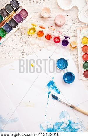 Top View Of Children's Drawings, Watercolors And Colorful Paints And Brushes. Creative Ideas, Creati