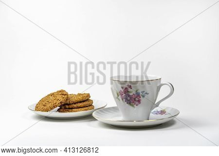 Dry Biscuit Biscuits From The Package Lie On A Saucer Next To A Cup For Tea