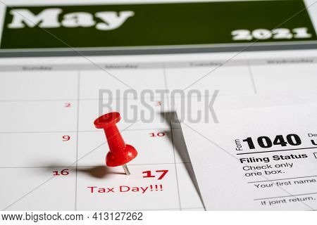 Calendar With Tax Day Note Inserted In The Date For May 17 To Illustrate The New Tax Return Filing D