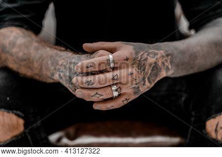 Close Up Of Professional Tattooer Artist. Tattoo Art On Body. Equipment For Making Tattoo Art. Maste