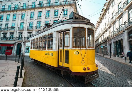 Trams In Lisbon. Tourist Attraction. A Famous Yellow Tram In Old Town Of Lisbon, Portugal. 10.03.202