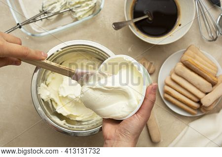 Mixing Mascarpone Cheese With Whipped Cream For Cake. Cooking Tiramisu Cake With Sponge Fingers Cook