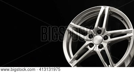 Alloy Wheel, Sporty Alloy, In The Shape Of A Star On A Dark Background. Empty Space Copyspace