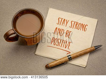 stay strong and be positive  inspirational handwriting on a napkin with a cup of coffee, positivity and personal development concept